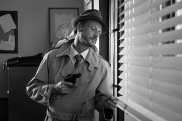 Spy agent peeking from a window