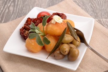 Appetizer with tomato, mozzarella and olives