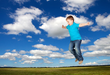 Happy child jumping on the medaw