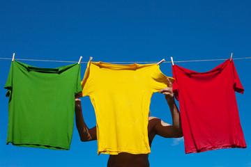Hand hanging shirt.