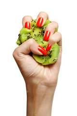 beauty female with red nails squeezing kiwi isolated
