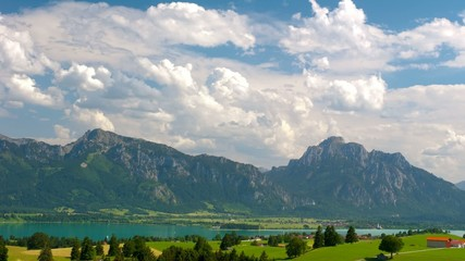 timelapse of moving clouds over alps mountains in Bavaria
