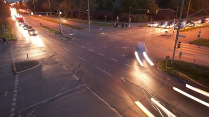 time lapse of car traffic on street crossing at night