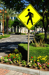 Traffic sign warning about pedestrian crossing. USA.