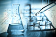 Laboratory research, dropping liquid to test tube - 72926864