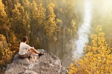 Hike tourist looks at beautiful view