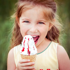 little girl eats ice-cream