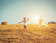 Leinwandbild Motiv happy little girl with a kite