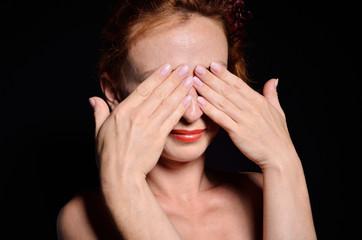 Woman hidden with her hands