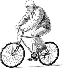 elderly man riding a bicycle
