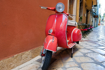 Classic Vespa scooter on Kerkyra street. Corfu island. Greece.