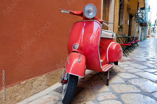 Classic Vespa scooter on Kerkyra street. Corfu island. Greece. - 72929630