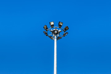 spotlights pillar on blue sky background
