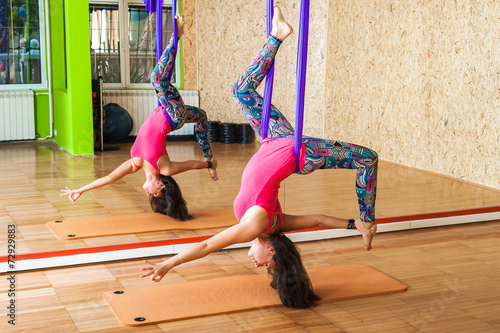 Papiers peints Fitness Woman doing aerial yoga