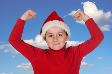 Happy child with Christmas hat celebrating something