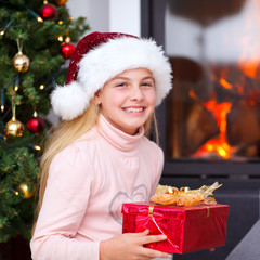 christmas -  little girl holding gift and smiling