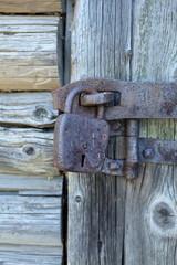 old padlock on the cracked door