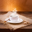 Coffee cup and saucer on  wooden table.