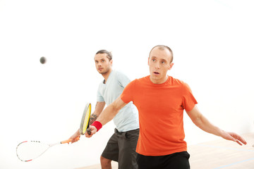 Two men playing match of squash
