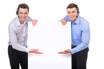 Smiling customer service male operator pointing to blank