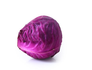 Head of red cabbage over white.