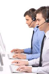 Customer service employee with headphones on white.