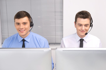 front view of customer service employee with headphones on white