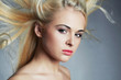 young beautiful blond woman.Beauty salon.Haircare.Flying hair