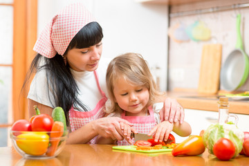 woman and kid girl preparing healthy food