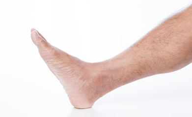 Man foot on white background