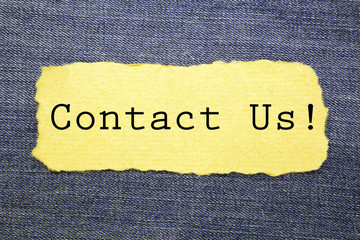 Contact Us text written on torn brown paper