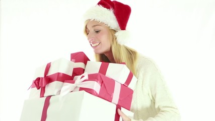 Happy young woman holding Cristmas presents