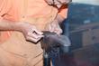 canvas print picture - Le cordonnier répare une chaussure