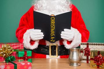 Santa reading Christmas A-Z