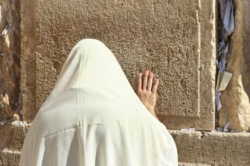 Orthodox Jewish man pray at the Wailing wall