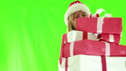 Surprise woman holding christmas presents
