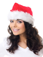 Friendly young woman in a red santa hat