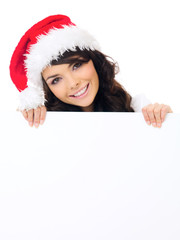 Friendly woman with a blank Christmas sign
