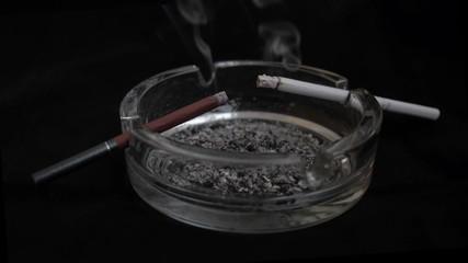 Two Smoking cigarettes. Black and white.