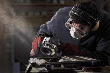 Cleaning  an item with an angle grinder.