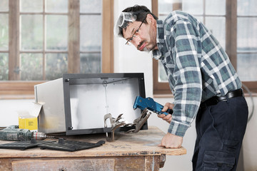 Metal worker in the workshop