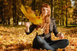 beautiful woman with red hair in fall park