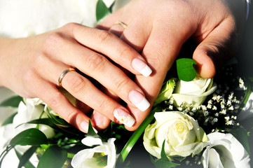 wedding rings on the hands of the newlyweds, wedding day