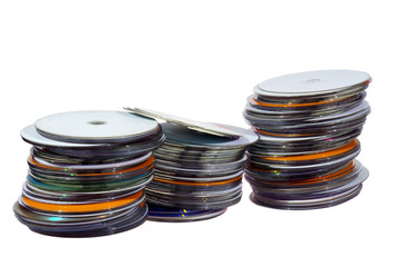 Three Stacks of Colorful Compact Discs on White