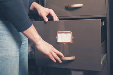 Man opening file cabinet