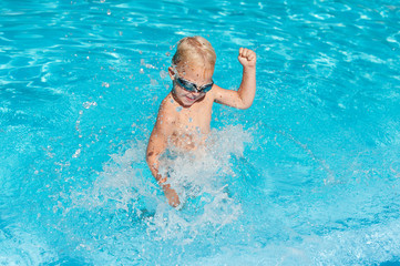 boy splashing in the water