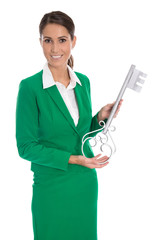 Isolated business woman in green holding key for dedicate a hous