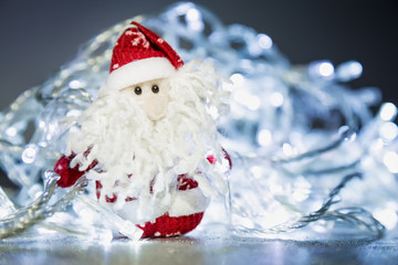 Santa Claus or Father Frost with Christmas lights