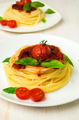pasta with  tomatoes, sauce and basil