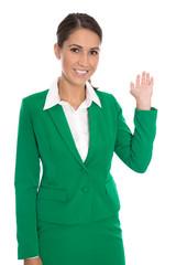 Isolierte Verkäuferin oder Beraterin in Grün mit Hand isoliert